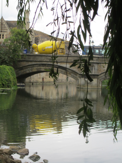 Cement truck on Stamford bridge from under the willow